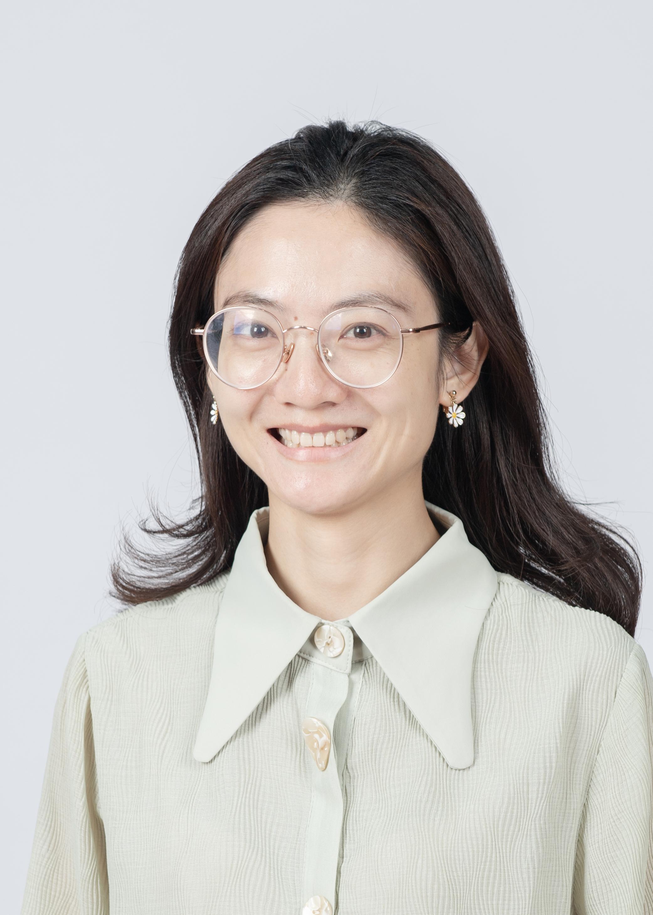 Ms. Ping Zhu